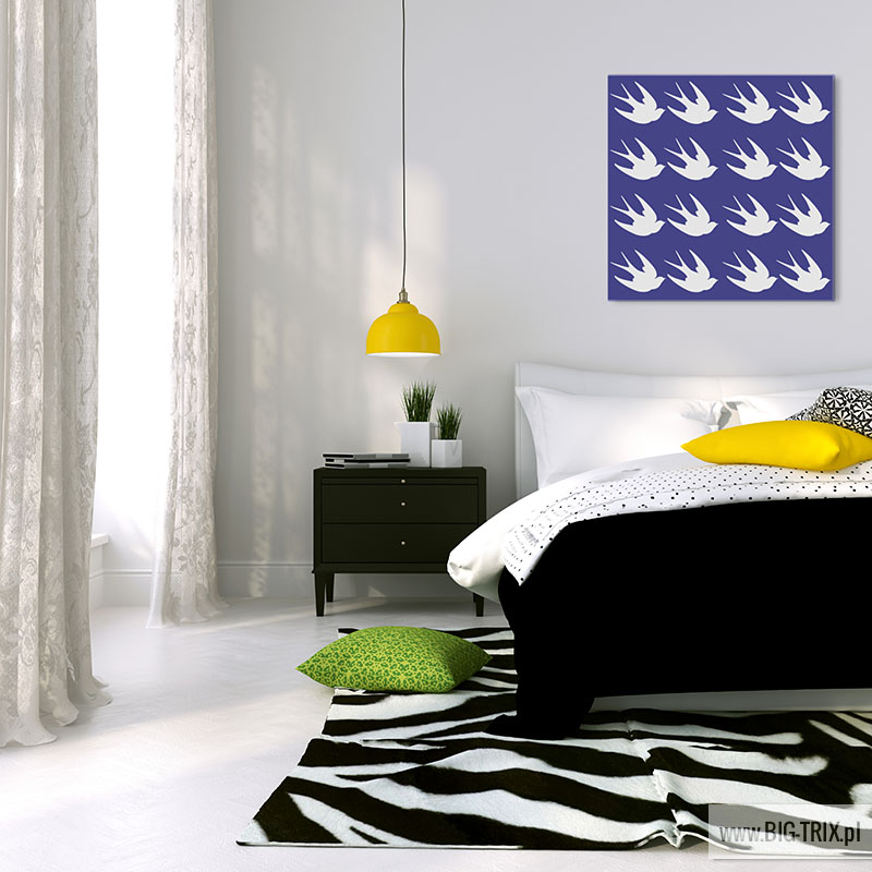 Black and white bed and a yellow lamp